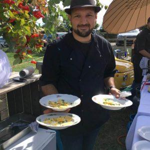 Chefitalie chef holding 3 plates of ravioli